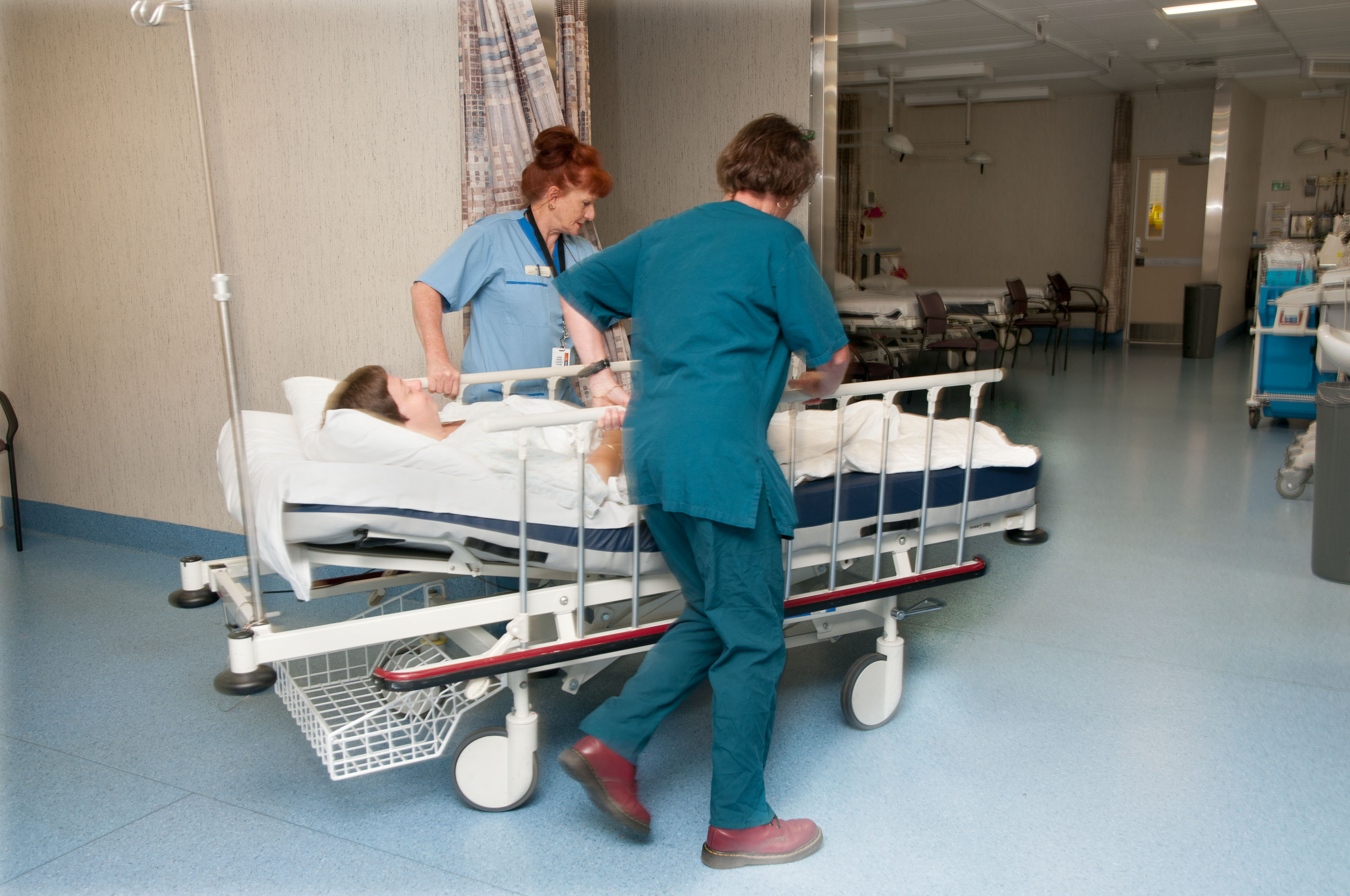 Nurse and Hspital Aide moving a patient.jpg