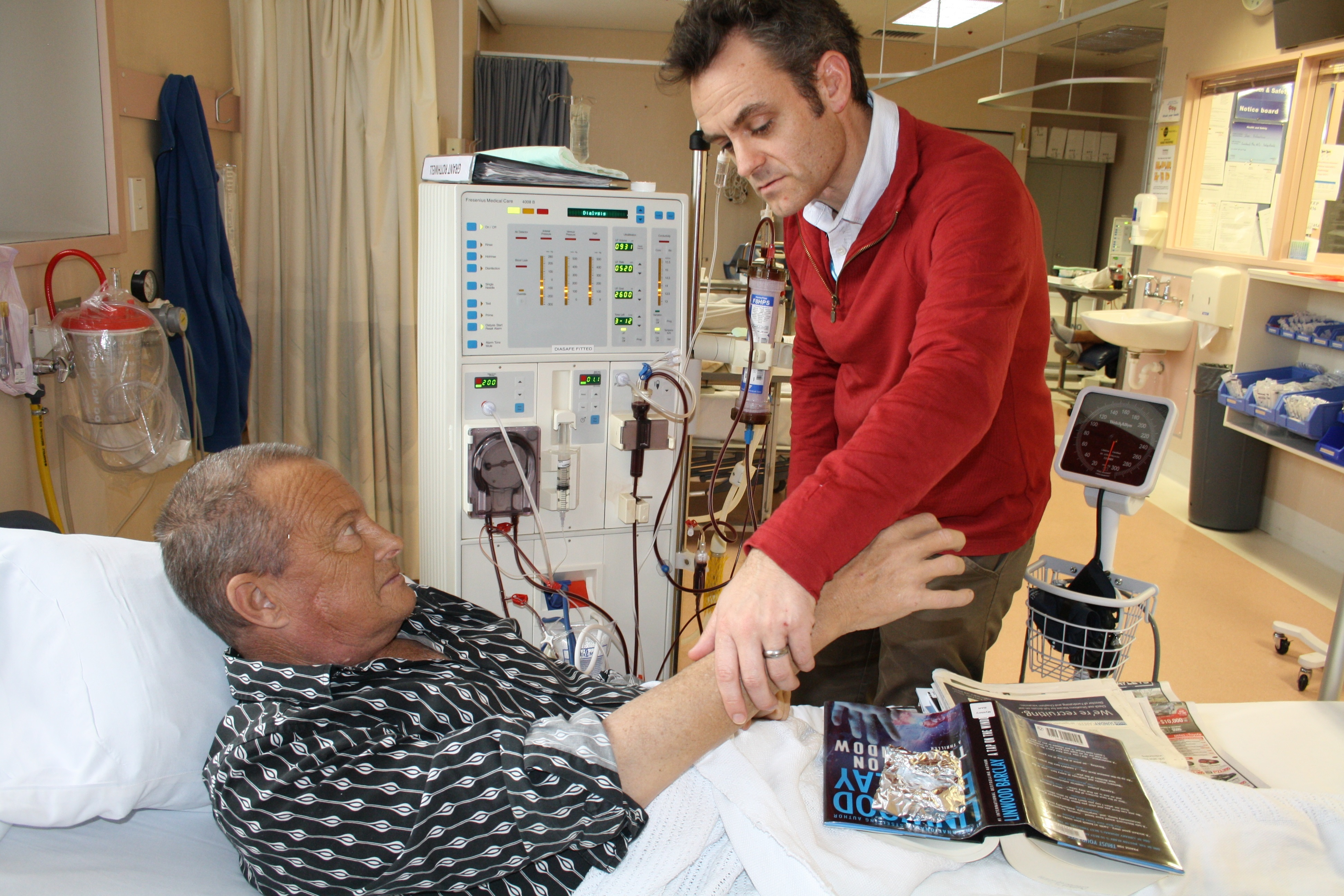 Nick Cross with patient.jpg
